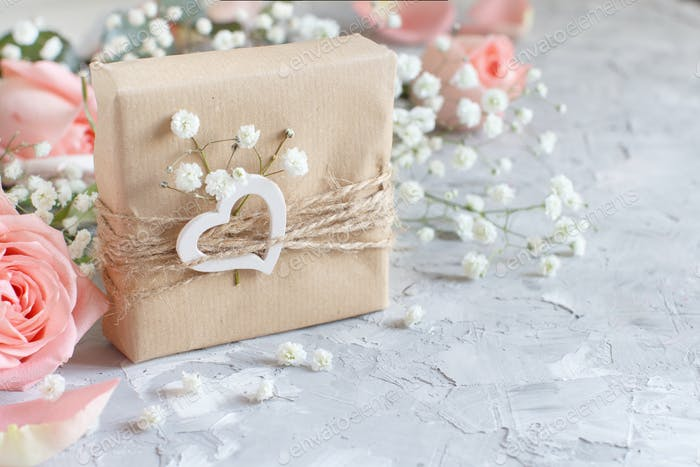 Gift boxes with small white flowers and hearts