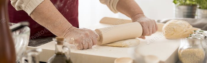 Grandmother rolling out pastry