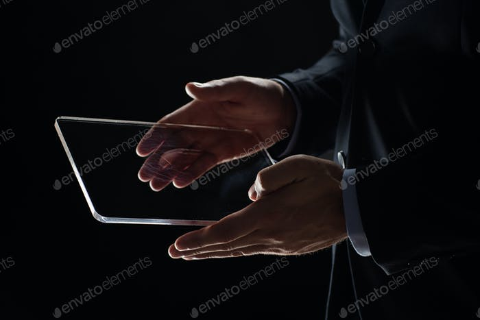 close up of businessman with transparent tablet pc
