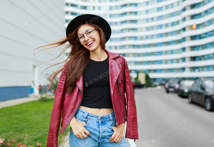 Lovely girl with candid smile  posing on the street .