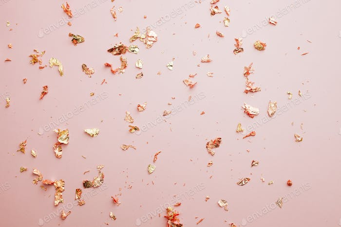 Pink shiny background with gold foil shiny confetti