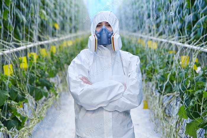 Plantation Worker in Protective Suit