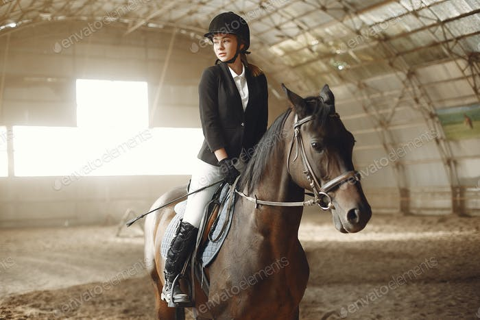 The rider in black form trains with the horse