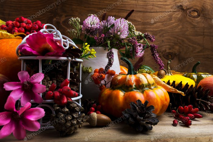 Fall arrangement with Turban squash, pink and purple flowers