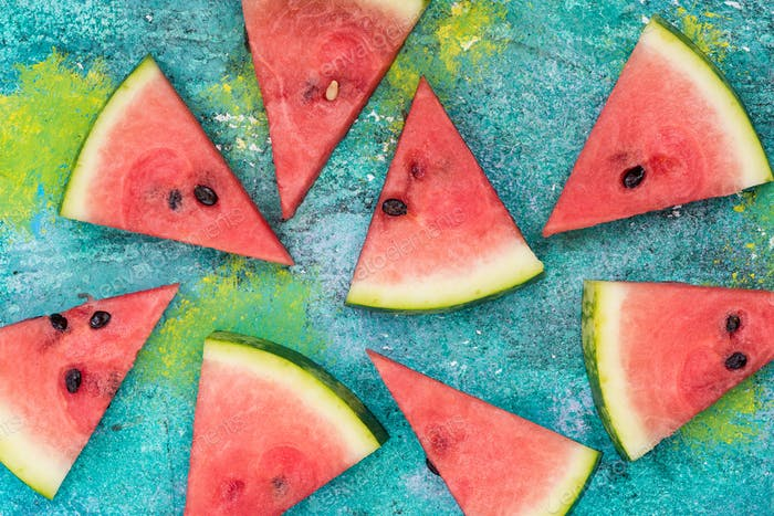 Watermelon slices on vibrant concrete slate