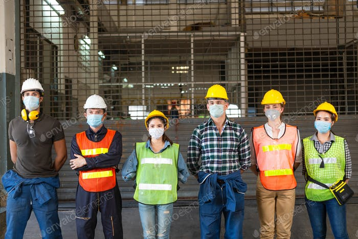 Group of industrial people standing at industrial factory