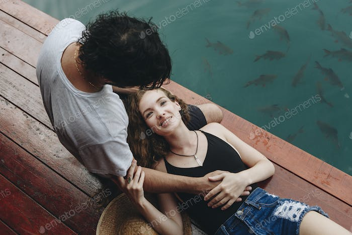 Woman relaxing in her boyfriends lap
