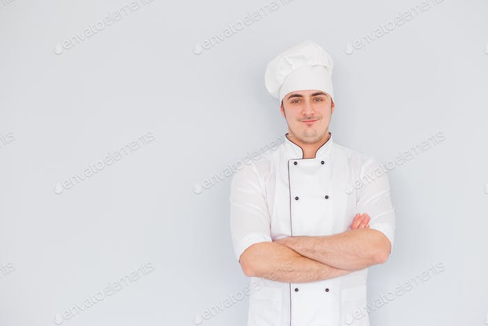 Portrait of a smiling chef cook on a white background
