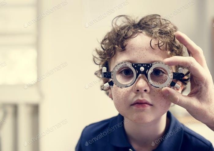 Little boy getting his eyes checked