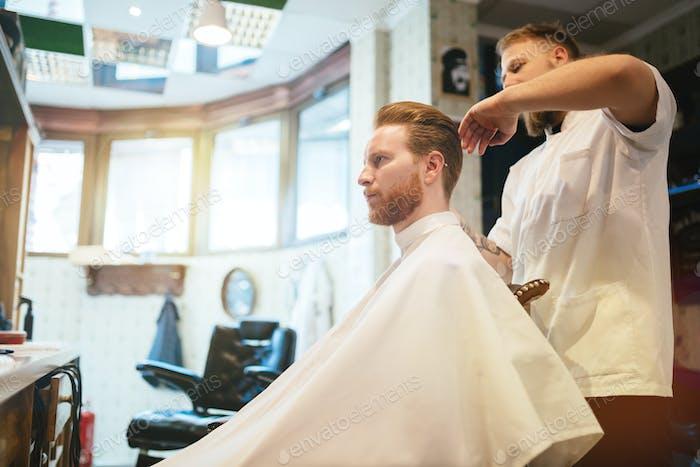 Male receiving hair beard mustache treatment