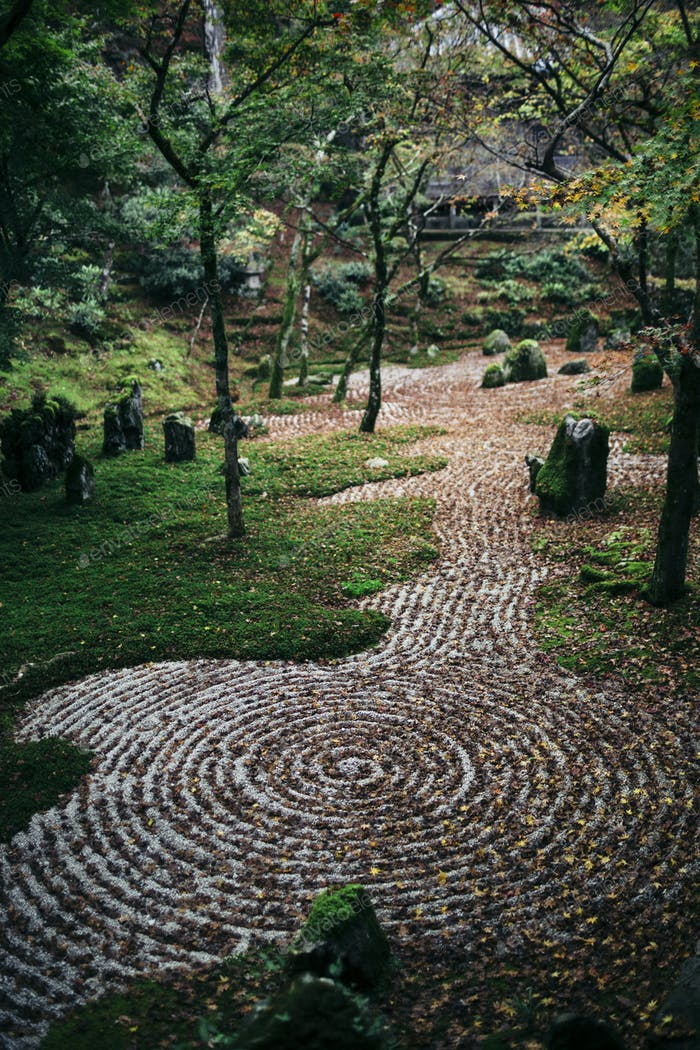 Gravel path with concentric patterns at a zen rock garden.