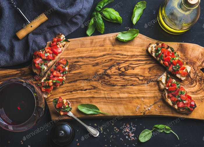 Tomato and basil bruschetta with glass