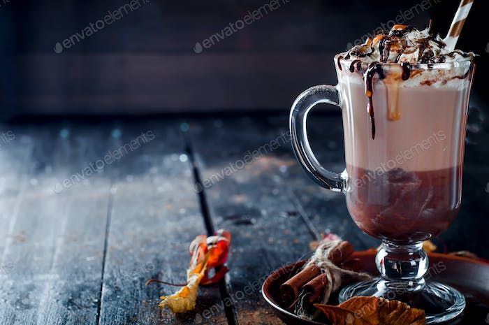 Autumn background with hot coffee cup
