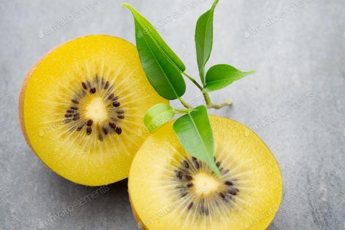 Kiwi fruit on a gray metal background.