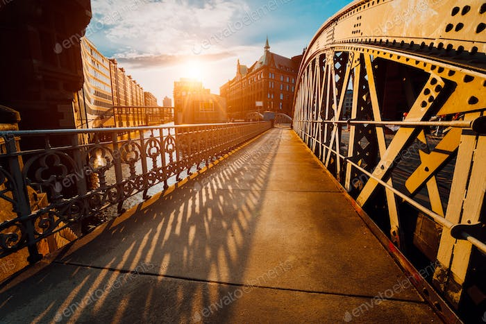 Bridge Arch with rivets in the Speicherstadt of Hamburg during sunset golden hour with sunset light