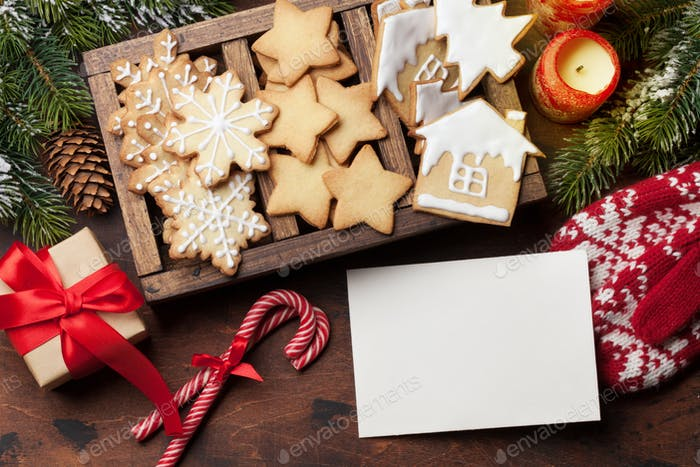 Christmas card with gingerbread cookies and fir tree