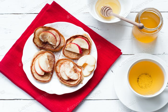 Pancakes with apple, cinnamon and honey