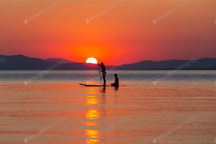 Two Gilrs Doing Stand Up Paddler Board 4
