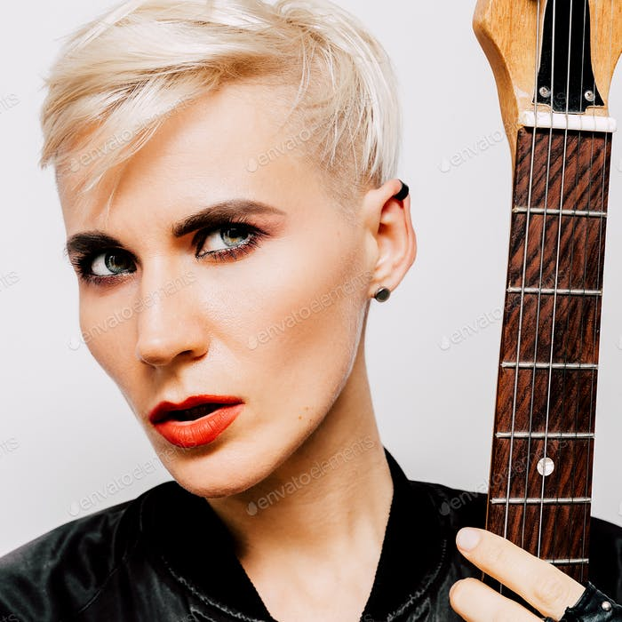 Blonde Model with electro guitar. Rock fashion style