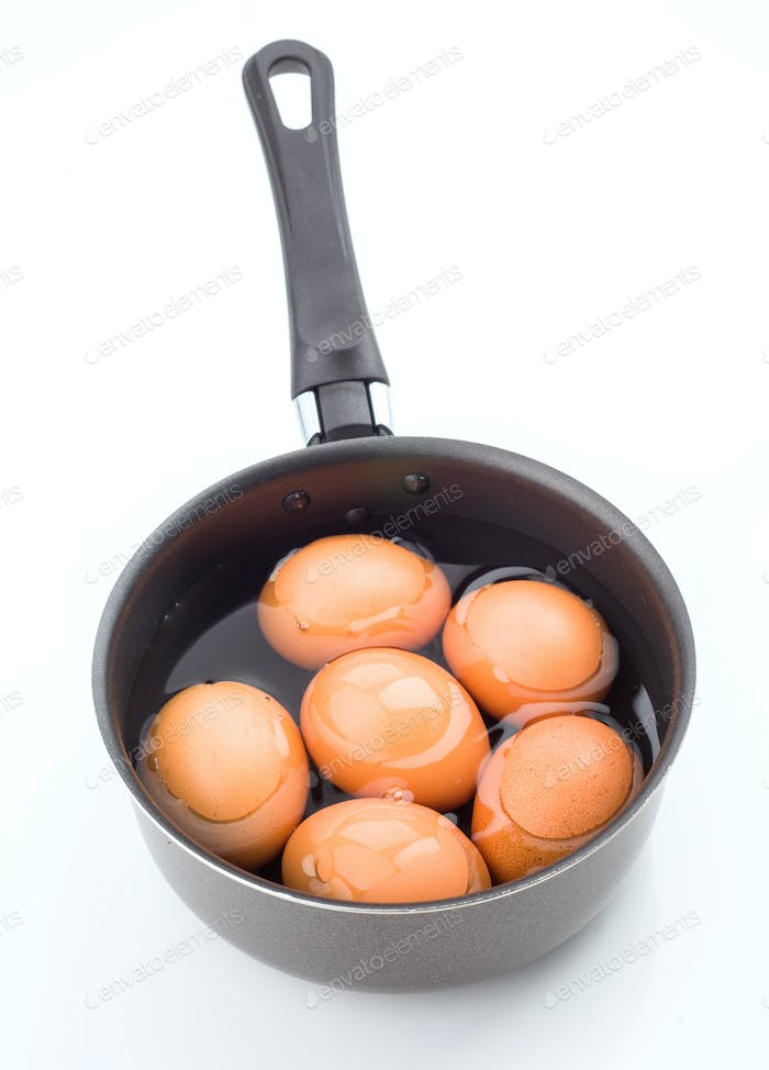 group of eggs immersed in water ready to be cooked