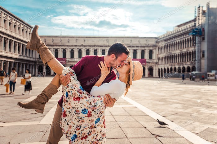 Romantic couple in love kissing in the city of Venice, Italy.