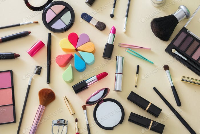 Make up cosmetics products against yellow color background
