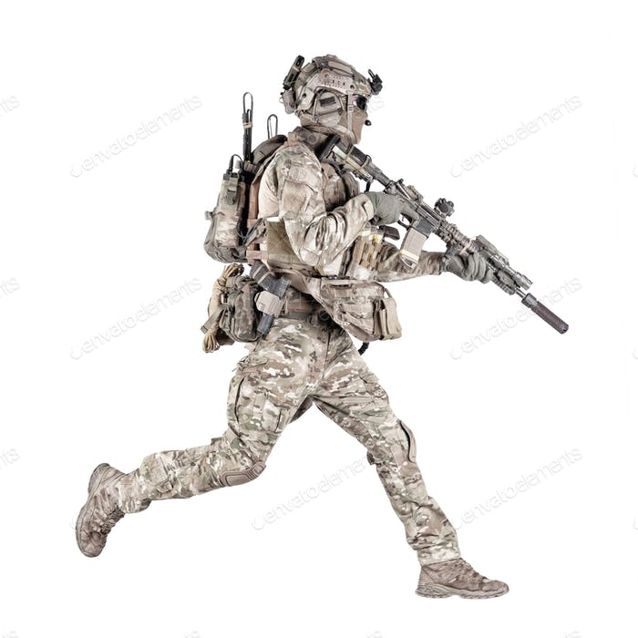 Running soldier with rifle isolated studio shoot
