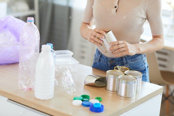 Activist sorting bottles waste