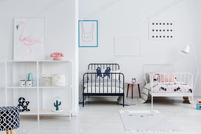 Siblings room interior with modern style metal beds, one white,