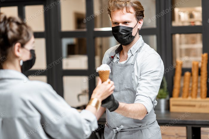 Salesman selling ice cream during pandemic time
