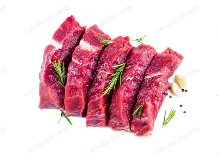Raw meat, beef steak with seasoning on white background, top view