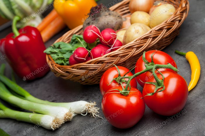 Fresh organic vegetables on rustic background