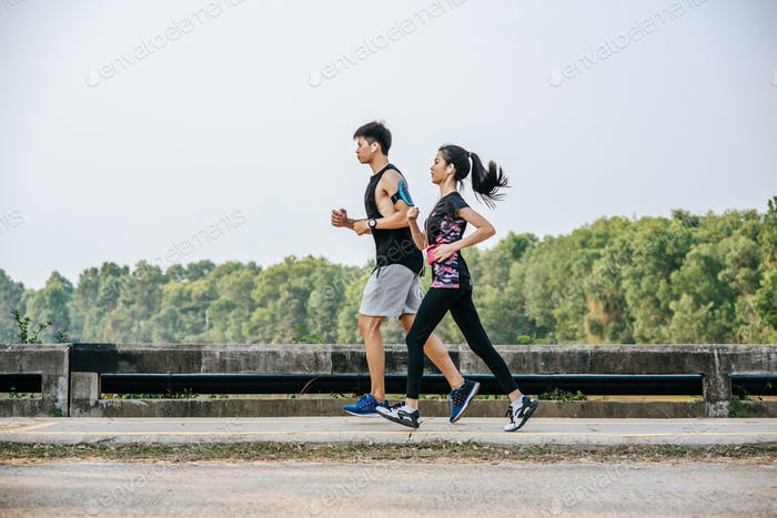Men and women exercise by running.