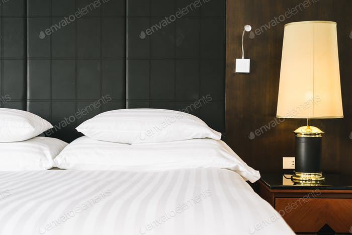 Beautiful luxury comfortable white pillow and blanket on bed wit