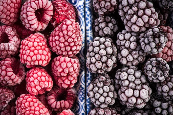 Frozen blackberry and raspberry fruits, close up
