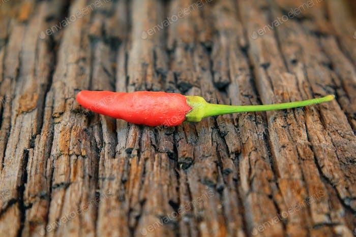Hot chili pepper on old wooden