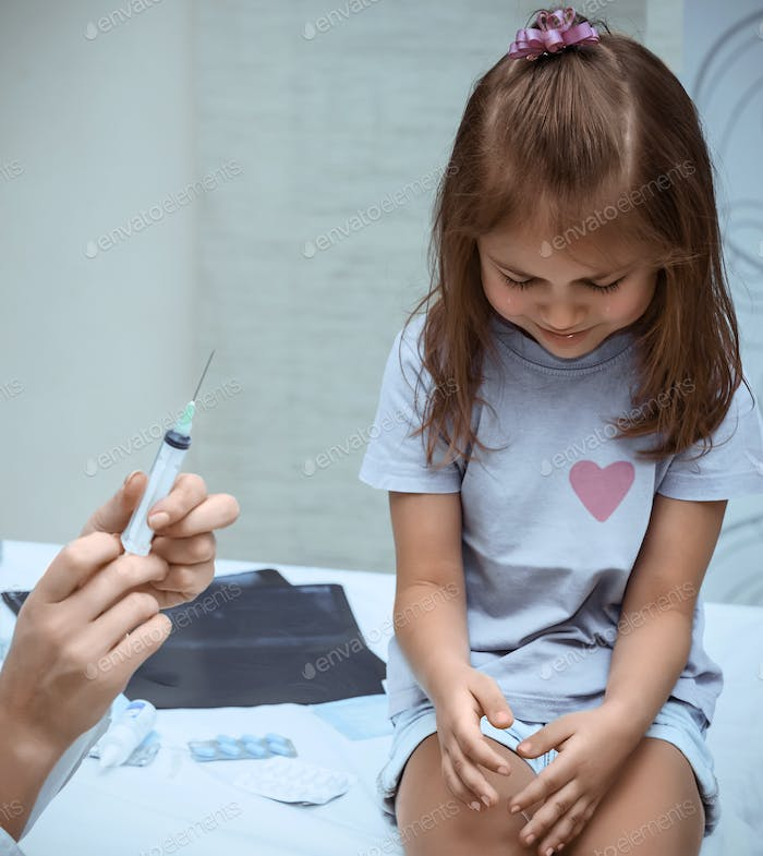 Little girl during vaccination