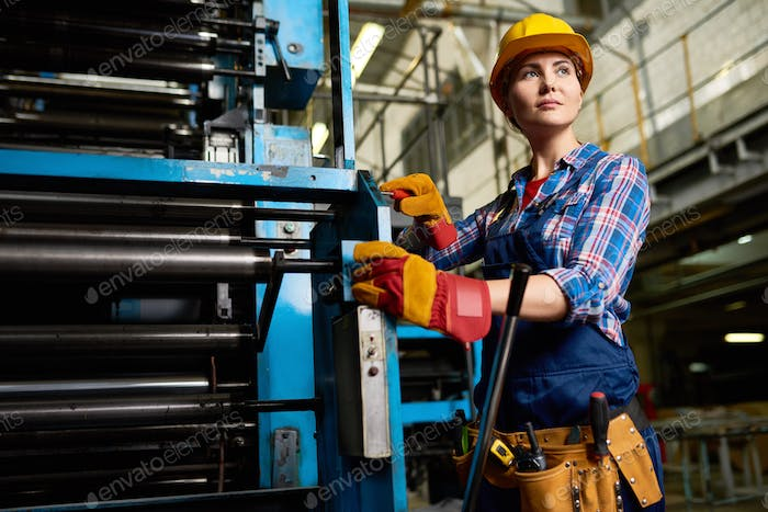 Young Woman Operating Machine Units in  Factory Workshop