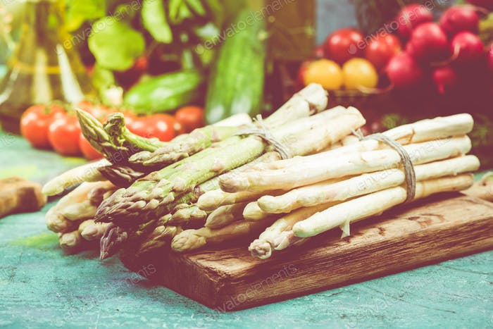 Bunch of fresh green and white asparagus