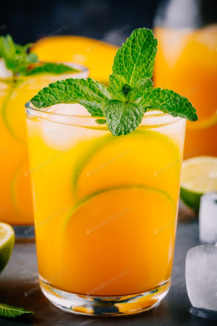 Fresh summer mango  juice with lime and mint