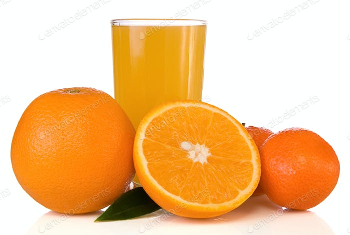 juice in glass and oranges on white