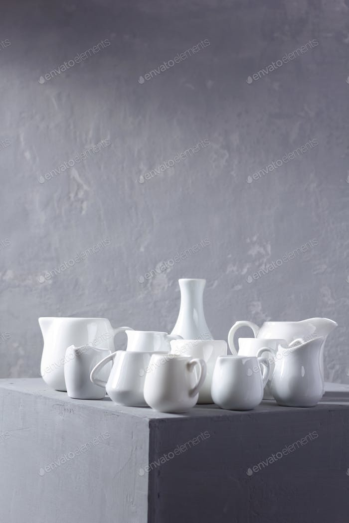 Empty milk jars or creamers dishes set. Kitchen dishware and tableware