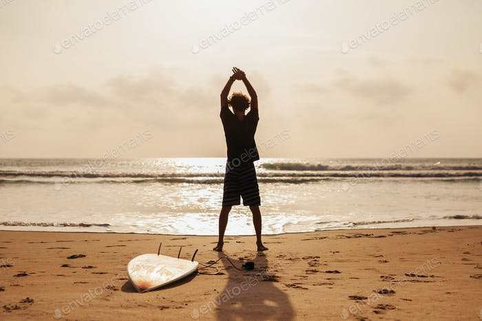 surfer man fitness on the beach
