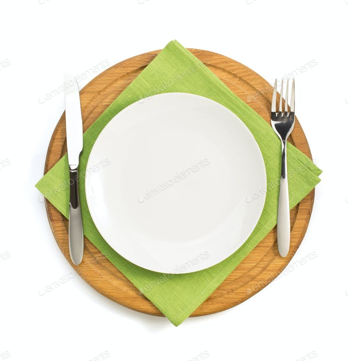 plate and fork with knife at napkin