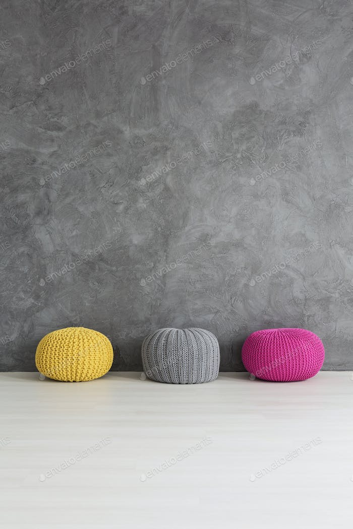 Three knitted poufs