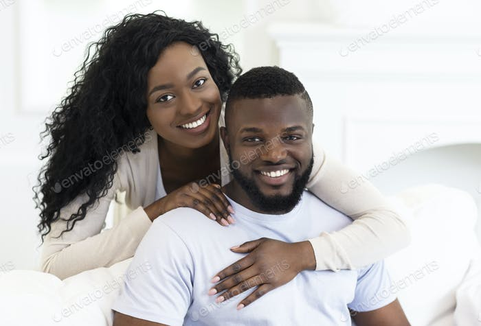 Portrait of happy millenial african american couple at home