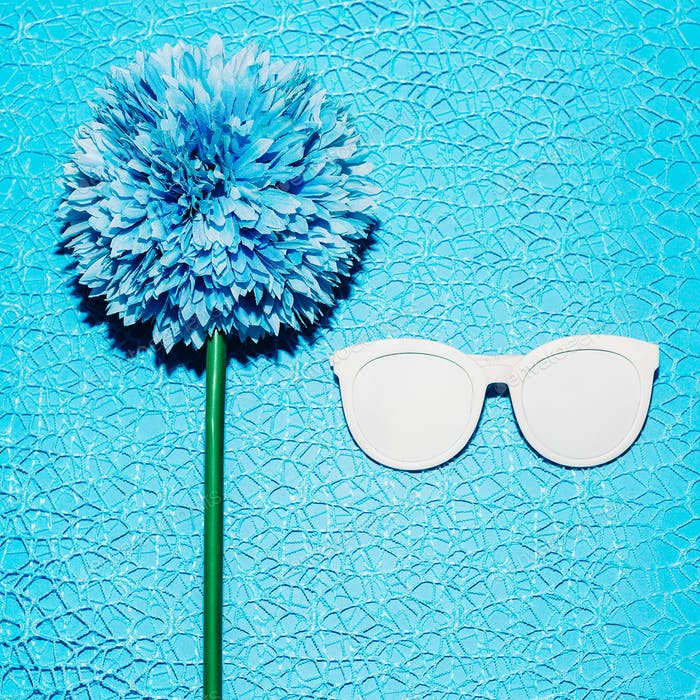 Blue flower and sunglasses. Minimal fashion style