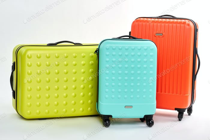 Group of three colorful suitcases