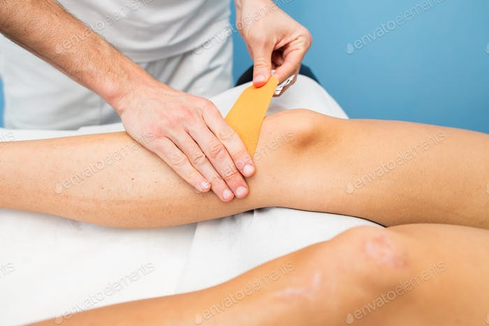 Kinesio taping knee application of a physiotherapist