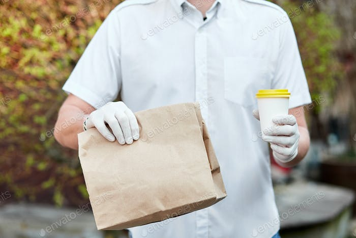 Courier, delivery man in protective mask and medical gloves during the coronavirus epidemic.